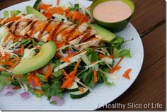 Buffalo Chicken Salad: Chopped romaine, shredded carrots, shredded sharp white cheddar, cucumbers, avocado, red onion with grilled chicken and buffalo ranch (mix ranch dressing and Texas Pete's WING sauce).