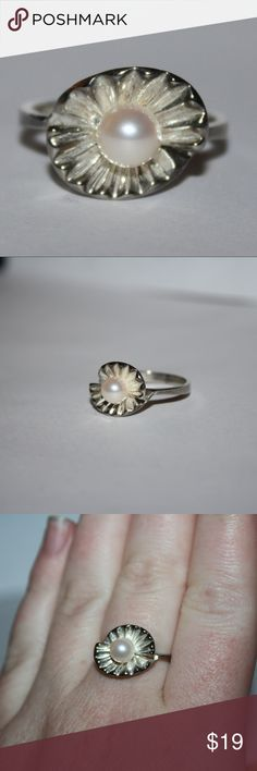 Sterling silver pearl flower ring size 8 adorable sterling silver pearl ring, size 8 Buy from me with confidence! I have sold over 300 items with a 5 star rating! If you have any questions, do not hesitate to ask.  Looking at a few things in my shop? Put a bundle together, comment on an item that you are ready to check out and let me send you an even better offer!  Thank you for visiting :) Free gifts with every purchase! Jewelry Rings
