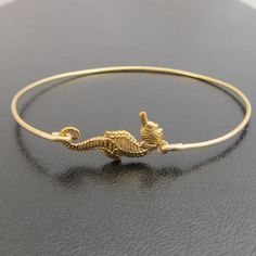 I LOVE THIS!! Seahorse Bracelet Seahorse Bangle Bracelet by FrostedWillow, $16.95