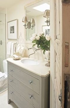 Gray painted vanity, wood, white counter, slate floors and white shower?