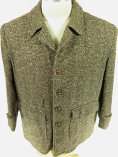 Vintage 50s Lakeland Tweed car coat with real leather knot buttons. Find more men's and women's authentic vintage clothing at The Clothing Vault.