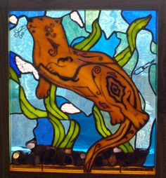 Kevin The Stained Glass Otter Swims the River. $220.00, via Etsy.