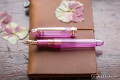 This fountain pen will put a new spring in your writing step! The Platinum 3776 Century Nice Lilas is a gorgeous pink pen with rose gold accents. Pin for later!