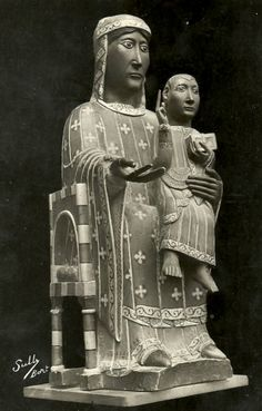 An 11th century Romanesque statue of Mary and Jesus with black features in Chastreix in Puy-de-Dôme, France.