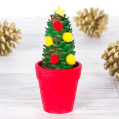 Mini Christmas Tree   Free Craft Ideas   Baker Ross  This cute little Christmas tree makes a great decoration for the Christmas table.
