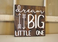 This dream big little one nursery wall decor features a dark stain with white painted letters. Great baby neutral nursery room idea! Custom