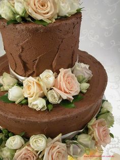 2 Tier Round: Chocolate Pallet Knife finish with ribbon & fresh flowers