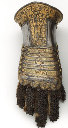 #Arms #Armor   Pair of Gauntlets. Ca. 1585. Steel, gold, silver, leather. Italian (Milan)
