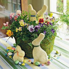 Easy Easter Decorations < Spring Table Settings and Centerpieces - Southern Living Easter Flowers Decorate your Easter table with colorful blooms, candies, and bunnies. Hide the flowers' container with moss for a fresh, Spring look. Easter Flower Arrangements, Easter Flowers, Spring Flowers, Easter Centerpiece, Centerpiece Flowers, Easter Colors, Flower Decoration, Basket Decoration, Centerpiece Ideas