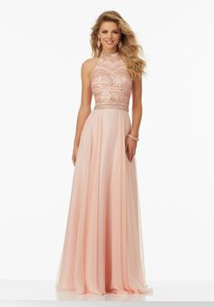 Prom Dresses by Morilee designed by Madeline Gardner. Beaded Chiffon Prom Dress with High Halter Neckline and Open Keyhole Back. Zipper Back Closure.