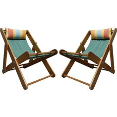 Pair of French 1930s Deckchairs  France  1930s  These French, 1930s folding deck chairs are made of birch and canvas. Each canvas seat is tied to the wood frame with leather straps.