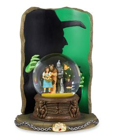 """A whimsical take on the musical snow globe, this charming keepsake features a colorful Wizard of Oz-inspired design that plays a little ditty from the classic movie.9.5'' HCeramicPlays """"Witch Song"""" and ''I'll get you my pretty"""" sound-biteRequires two AA batteries (not include..."""