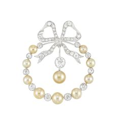 Belle Epoque Platinum, Gold, Natural Button Pearl and Diamond Circle Bow Brooch composed of and suspending 10 golden pearls spaced by old European-cut diamonds, centering one old European-cut diamond, topped by a diamond-set bow, totaling 41 old European-cut diamonds. c1905.