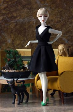 """by Joey Versaw models Yatabazah Luxury Wigs and """"Classic Black Dress"""" by Robert Best. Her shoes are 3D printed."""
