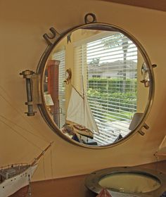 Brass Porthole Mirror- Nautical Coastal Decor Code: 3928   Price: $139.95   Shipping Weight: 12.50 pounds