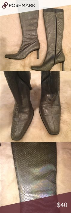 Calvin Klein Silver Knee High zip up boots Shimmery silver/grey that has purply green tones when it hits the light in a certain way. Like a beautiful mermaid tail!! Knee high. Zippers work well. Boot in excellent condition. Just wear on the bottoms and heels. 3 inch heel. Stored in a box in a pet/smoke free home. Calvin Klein Shoes Heeled Boots