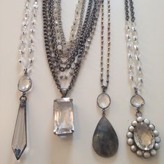 Silver and gunmetal with gemstones.