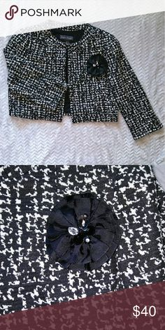 Black & White Cropped Jacket Black and white cropped jacket with a black jeweled flower brooch. Has shoulder pads, but they can be easily removed if you don't like them. Great for professionals that like vintage inspired clothing! Jessica Howard Jackets & Coats Blazers