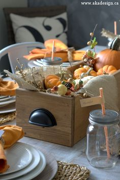 Fill a wooden trough with gourds for a rustic Thanksgiving centerpiece... via akadesign.com