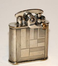 Art Deco Silver lighter on eBay Buy It Now Price $200.00 Used in Collectibles, Tobacciana, Lighters
