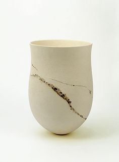 annsymes:    Jennifer Lee  Pale, haloed granite traces, bronze specks