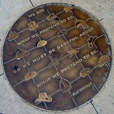 "Manhole Cover - Kurt Vonnegut quote -- ""We are what we pretend to be, so we must be careful who we pretend to be."""