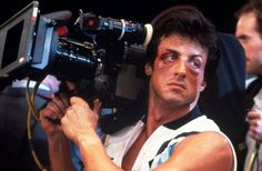 Sylvester Stallone with a camera at Rocky II (1979) set.