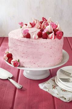 Raspberry Pink Velvet Cake:  Decorated with fresh raspberries, meringue cookies and edible flowers, this pink velvet cake would be a fun and cheerful addition to any bridal shower or birthday party.