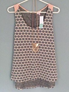 love this top! not a huge fan of pink but love the color combo, print, and style