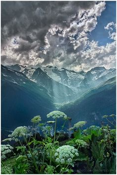 Clouds & sun rays in Dombay, Russia