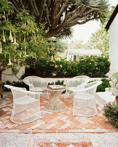 Brick patio with a herringbone pattern