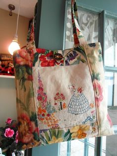 A handmade bag - Vintage floral fabrics and a hand embroidered linen panel, featuring a crinoline lady in her cottage garden.        The b...