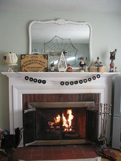 A Halloween mantel display at http://www.flickr.com/photos/goldenpaws/2077076824/ #mantel #halloween #display