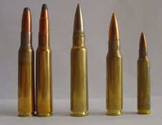 Two 7x57 cartridges (left) next to 7.5x55 Swiss / GP11 (mid), .308 Winchester and .223 Remington (right).