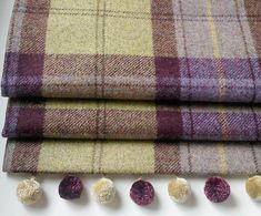 A stylish handmade roman blind in purple and soft khaki tweed with contrast bobble trim. Made to measure to your window sizes, and blackout lined.All our blinds are handsewn here in our Cheshire workroom and have no visible stitch lines across the front of the blinds. Supplied on a deluxe metal headrail with right hand side chain mechanism. Fabric swatches available. Easy to order:-Select the price bracket that your required blind falls into. Enter the size of the blind you require. Please…