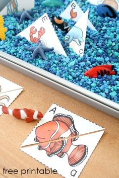 Ocean ABC Sensory Bin-Preschool Ocean Theme activity for sensory play and letter recognition. Free printable included