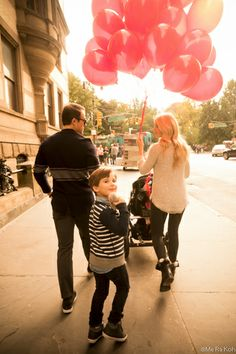 Little boy with red balloons in NYC, 7 women Photographers capture thankfulness, Me Ra Koh