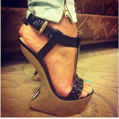 giuseppe zanotti black and gold heeless sculpted wedges #shoeporn #actionshot