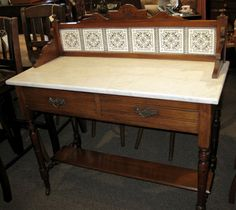 This wonderful antique mahogany marble topped washstand is just $449! Makes a great desk, hall table or even a sink base! sold