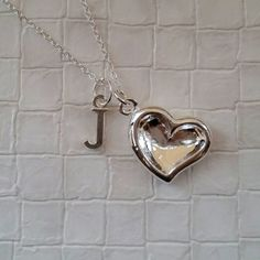 Check out this item in my Etsy shop https://www.etsy.com/listing/226151133/personalised-silver-heart-necklace