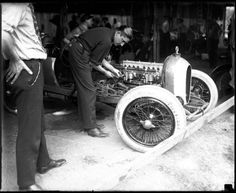 "Millionaire race car driver Russell ""Cliff"" Durant works on his Durant Special in the garage. Durant was the son of William C. Durant, the founder of General Motors. Durant competed in six Indianapolis 500 races from 1919 to 1928."