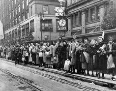 Downtown Detroit. Waiting for the trolley on State Street. 1949