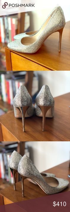 Authentic Jimmy Choo Glitter Fabric Heels (38.5) Authentic Jimmy Choo pumps with original box.  They have signs of use on the inside and the bottom of the shoe - but the heels and fabric are in excellent condition.  They look good as new on.  I'm a size 7.5 normally but 38.5 in Jimmy Choos (they run small).  The fabric is gold/silver and the heels is gold.  Super cute! Jimmy Choo Shoes Heels