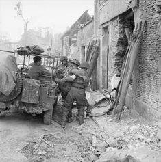 A casualty is brought in by jeep to a 3rd Division regimental aid post near Caen, 9 July 1944.