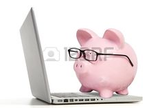 The pink pig works on the computer