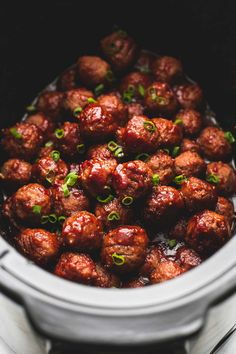 Easy 3 Ingredient Slow Cooker Sweet 'N Spicy Party Meatballs will be the hit of your next get together. Easy to make ahead and so yummy not a single one will be leftover.