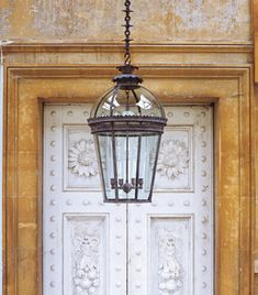 Give your porch the grand touch with the large Hyde glazed hanging lantern is based on an antique original, in brown bronze finish, £4,800, jamb.co.uk Best Outdoor Lighting, Porch Lighting, Hall Lighting, Island Lighting, Exterior Lighting, Kitchen Lighting, Pendant Chandelier, Lantern Pendant, Vintage Chandelier