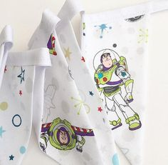 For those Toy Story fans out there!  Buzz Lightyear Bunting in shades of White, Lime Green, Blues etc.  There are a total of seven flags, measuring just under one metre, with excess tape at either end of the bunting for tying or pining the bunting up Please be aware that the placement of