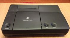 The Sega Pluto is a prototype console. It's a version of the Sega Saturn with a Netlink modem built into it. Vintage Video Games, Retro Video Games, Vintage Games, Sega Cd, Playstation, Xbox Games, Pinball Games, Penny Arcade, Sega Saturn