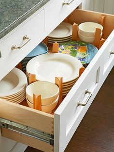 Bring your kitchen to order by keeping plates and bowls organized in a deep drawer. More ways to organize kitchen cabinets: http://www.bhg.com/kitchen/storage/how-to-organize-kitchen-cabinets/?socsrc=bhgpin071813deepdrawer=8